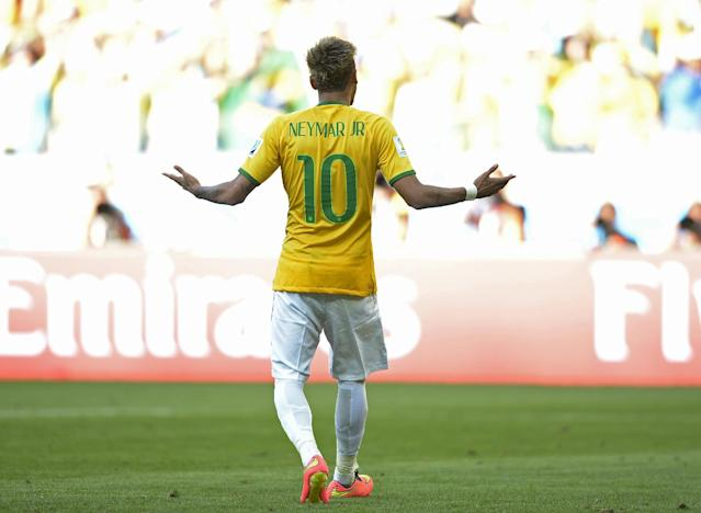 Brazil's Neymar reacts after getting a goal during a penalty shootout after regulation time during the World Cup round of 16 soccer match between Brazil and Chile at the Mineirao Stadium in Belo Horizonte, Brazil, Saturday, June 28, 2014. Brazil won 3-2 on penalties after a 1-1 tie. (AP Photo/Manu Fernandez)