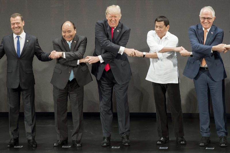 President Donald Trump was thrown off by a handshake intended to kick off an international conference in the Philippines on Monday.