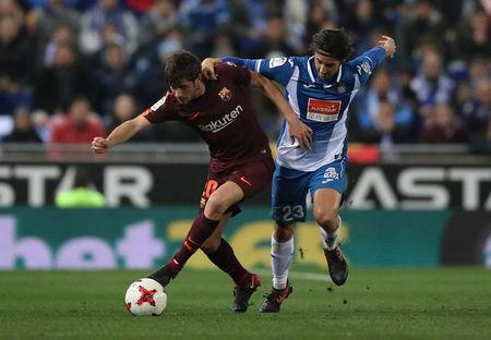 Soccer Football - Spanish King's Cup - Espanyol vs FC Barcelona - Quarter-Final - First Leg - RCDE Stadium, Barcelona, Spain - January 17, 2018 Barcelona's Sergi Roberto in action with Espanyol's Esteban Granero REUTERS/Albert Gea