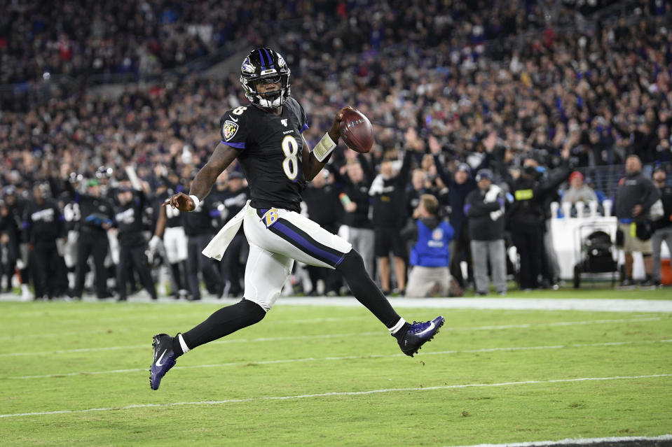 Baltimore Ravens quarterback Lamar Jackson scores on a run against the New England Patriots during the first half of an NFL football game, Sunday, Nov. 3, 2019, in Baltimore. (AP Photo/Nick Wass)