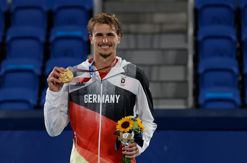 Alexander Zverev celebrates with his gold medal after winning the men's singles final at the Tokyo Olympics.