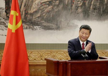 China's President Xi Jinping claps after his speech in Beijing
