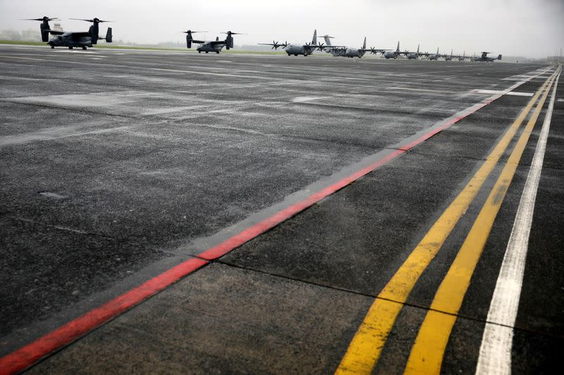A Bell Boeing V-22 Osprey aircrafts and C-130 transport planes prepare to take off during a military drill amid the coronavirus disease (COVID-19) outbreak, at Yokota U.S. Air Force Base in Fussa, Japan