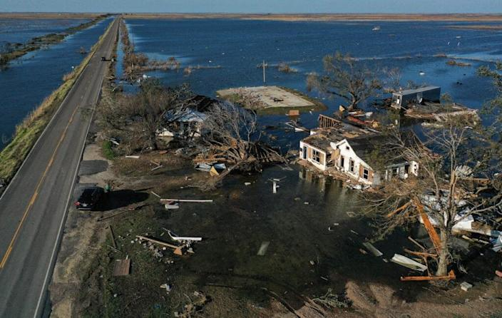 An aerial view of flood waters from Hurricane Delta surrounding structures destroyed by Hurricane Laura (R) on October 10, 2020 in Creole, Louisiana. (Photo by Mario Tama/Getty Images)