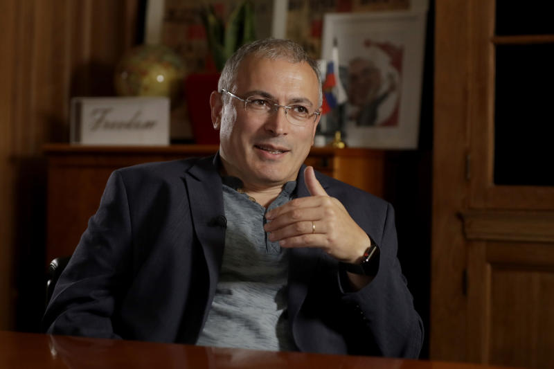 FILE - In this July 24, 2018 file photo, Russian opposition figure Mikhail Khodorkovsky speaks during an interview by The Associated Press in London. Two prominent Kremlin critics warn that electing a top Russian police official to be president of Interpol would undermine the international law enforcement agency and politicize police cooperation across borders. Bill Browder, who runs an investment fund that once operated in Moscow, and Khodorkovsky told reporters that President Vladimir Putin has tried to use Interpol to hunt down critics such as themselves to stifle dissent. (AP Photo/Matt Dunham, File)