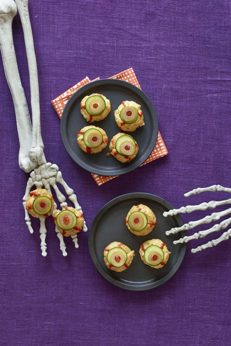 """<p>These cheesy puff pastries, which only call for four ingredients, will be gone in the blink of an eye.</p><p><strong><em><a href=""""https://www.womansday.com/food-recipes/recipes/a60165/bitesize-eyeballs-recipe/"""" rel=""""nofollow noopener"""" target=""""_blank"""" data-ylk=""""slk:Get the Bite-Size Eyeballs recipe."""" class=""""link rapid-noclick-resp"""">Get the Bite-Size Eyeballs recipe. </a></em></strong></p>"""