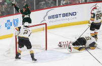 Minnesota Wild's Joel Eriksson Ek, top left, celebrates his power play goal off Vegas Golden Knights' goalie Marc-Andre Fleury, right, in the first period of an NHL hockey game Tuesday, Feb. 11, 2020, in St. Paul, Minn. (AP Photo/Jim Mone)