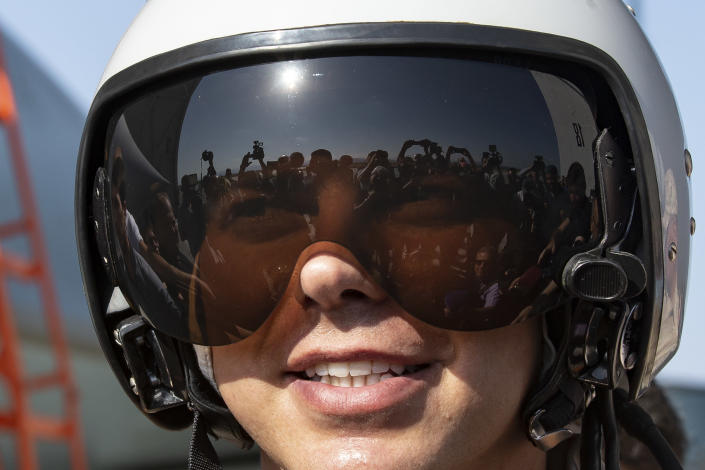 Russian air force pilot Ivan, no second name given, smiles as he speaks to foreign journalists at a Su-35 fighter jet at Hemeimeem air base in Syria, Thursday, Sept. 26, 2019. (AP Photo/Alexander Zemlianichenko)