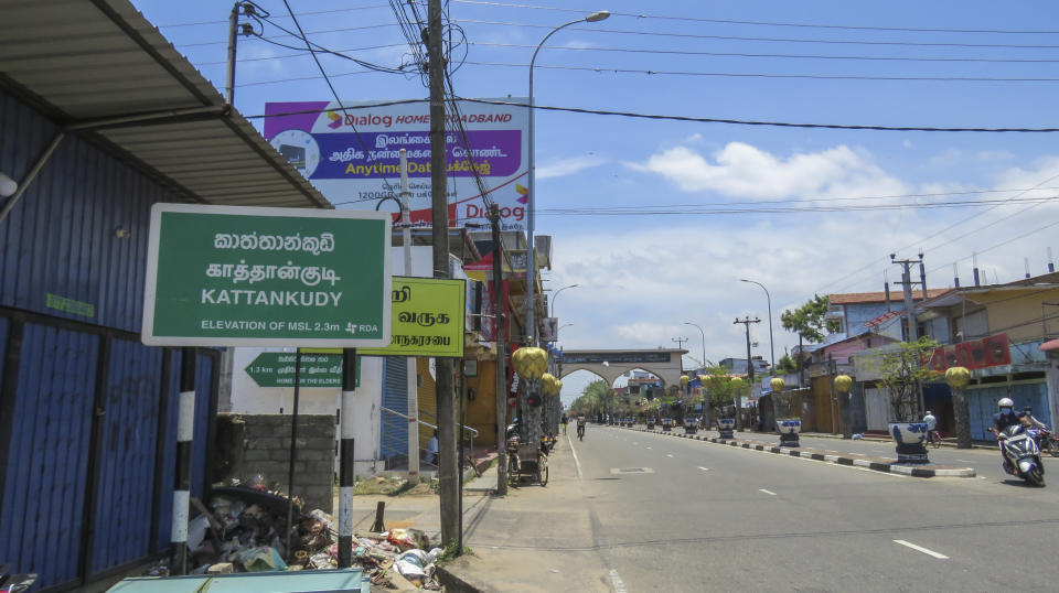 Light traffic moves down a street in Kattankudy, a Muslim-majority town in the eastern province of Sri Lanka, Sunday, Sept. 5, 2021. Kattankudy is the home town of Ahamed Aathil Mohamed Samsudeen, an Islamic State-inspired extremist who attacked shoppers in a New Zealand supermarket on Friday, Sept. 3, 2021. (AP Photo/Kanagarasa Saravanan)