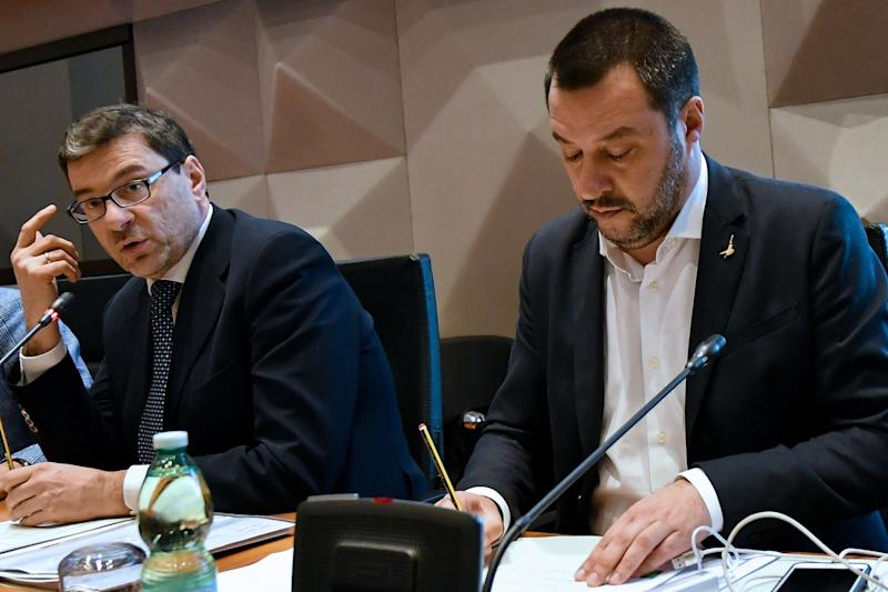 Secretary of the Council of Ministers Giancarlo Giorgetti (L) and Italy's Interior Minister and deputy PM Matteo Salvini (R) attend a meeting with the National Observatory on sporting events, in Rome, on January 7, 2019. (Photo by Alberto PIZZOLI / AFP) (Photo credit should read ALBERTO PIZZOLI/AFP/Getty Images) (Photo: ALBERTO PIZZOLI via Getty Images)