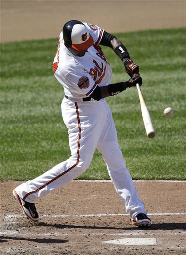 Baltimore Orioles' Wilson Betemit gets a hit in the sixth inning of a baseball game against the Minnesota Twins in Baltimore, Sunday, April 8, 2012. Adam Jones and Nick Johnson scored. Baltimore won 3-1. (AP Photo/Patrick Semansky)