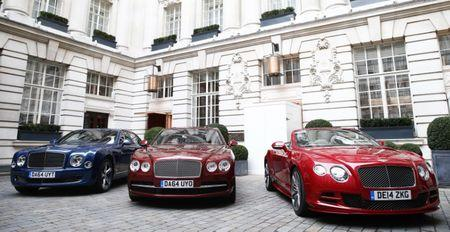 A Bentley Mulsanne Speed, a Bentley Flying Spur, and a Bentley GTC Speed are lined up in the courtyard of a hotel in central London