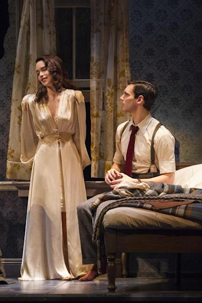 """This theater image released by The O+M Company shows Cory Michael Smith, right, and Emilia Clarke as Holly Golightly in a scene from """"Breakfast at Tiffany's,"""" performing at the Cort Theatre in New York. Clarke's costumes were designed by three-time Academy Award-winning costume designer Colleen Atwood. (AP Photo/The O+M Company, Nathan Johnson Photography)"""