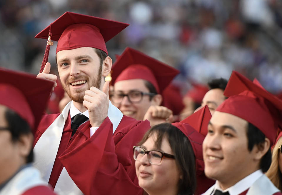 Students earning degrees at Pasadena City College participate in the graduation ceremony, June 14, 2019, in Pasadena, California. (Photo: ROBYN BECK/AFP via Getty Images)