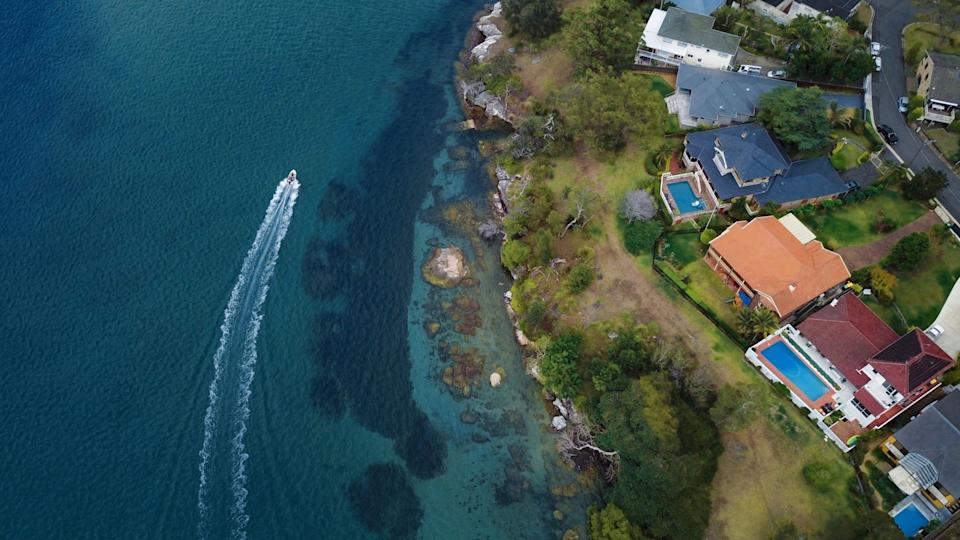 Aerial View of Luxury Waterfront Houses by the Ocean