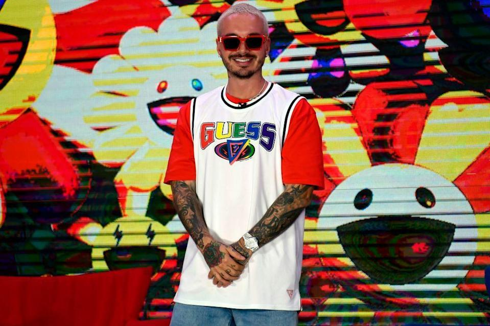 """<p>Born in Medellín, Colombia, J. Balvin is a world-renowned reggaetón singer, often referred to as the """"<a href=""""https://open.spotify.com/artist/1vyhD5VmyZ7KMfW5gqLgo5/about"""" rel=""""nofollow noopener"""" target=""""_blank"""" data-ylk=""""slk:Prince of Reggaeton"""" class=""""link rapid-noclick-resp"""">Prince of Reggaeton</a>."""" After <a href=""""https://history-biography.com/j-balvin/"""" rel=""""nofollow noopener"""" target=""""_blank"""" data-ylk=""""slk:moving to the U.S."""" class=""""link rapid-noclick-resp"""">moving to the U.S.</a> at age 17, his love for music grew deeper and he eventually returned to Colombia inspired to release original hits. More than a decade later, J. Balvin has collaborated with countless artists like <strong>Farruko</strong>, <strong>Daddy Yankee</strong>, <strong>Bad Bunny</strong>, <strong>Zion & Lennon</strong>, <strong>Rosalía</strong>, and <strong>Dua Lipa</strong>.</p>"""