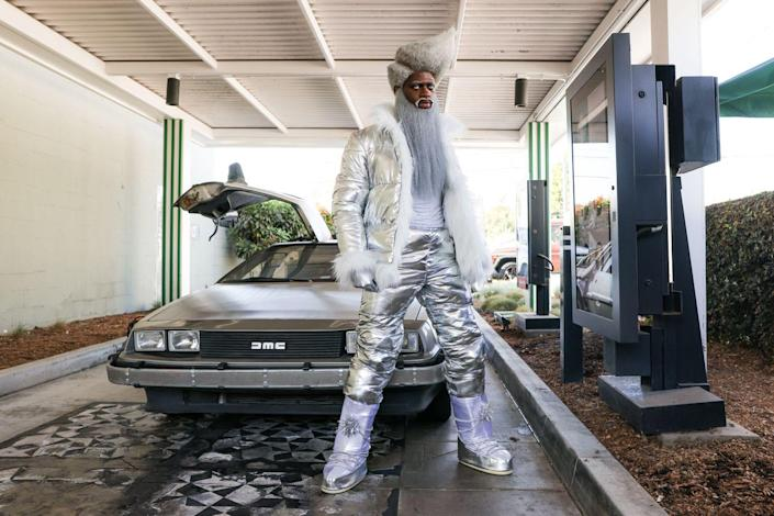 """<p>Here, he sported a futuristic Santa Claus look around Los Angeles to promote the track """"Holiday."""" He definitely <a href=""""https://www.youtube.com/watch?v=AkSG5IttE9Q"""" rel=""""nofollow noopener"""" target=""""_blank"""" data-ylk=""""slk:turned some heads"""" class=""""link rapid-noclick-resp"""">turned some heads</a> wearing the all-metallic outfit. </p>"""