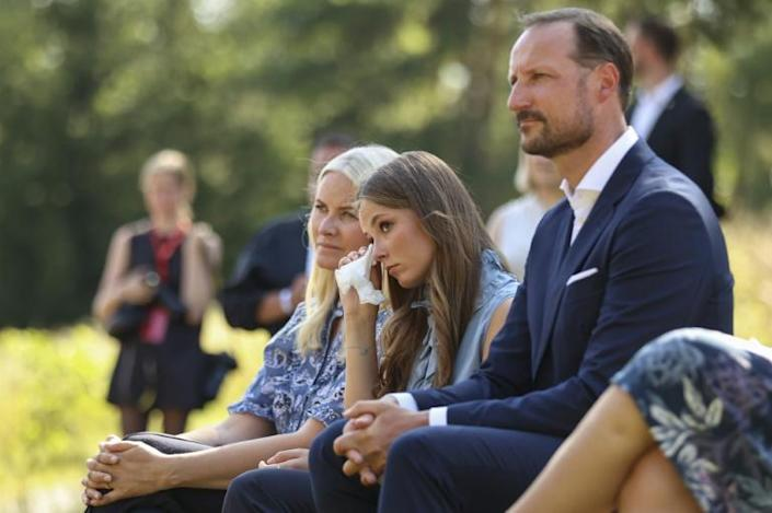 Crown Prince Haakon (R) told survivors: 'We must dare to talk about what happened even if it is uncomfortable'