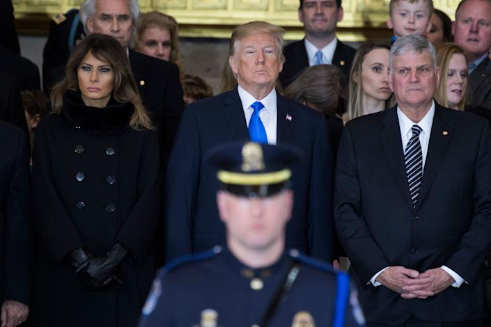 President Donald Trump, first lady Melania Trump and Franklin Graham attend a ceremony in the Capitol Rotunda as the late Rev. Billy Graham, the father of Franklin, lies in honor on Feb. 28, 2018. (Photo: Tom Williams via Getty Images)