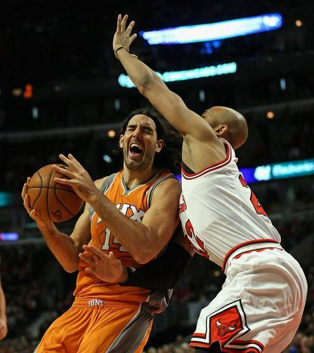 CHICAGO, IL - JANUARY 12: Luis Scola #14 of the Phoenix Suns is fouled by Taj Gibson #22 of the Chicago Bulls at the United Center on January 12, 2013 in Chicago, Illinois. (Photo by Jonathan Daniel/Getty Images)