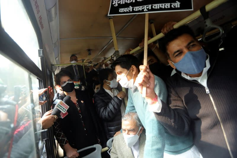 Priyanka Gandhi, a leader of India's main opposition Congress party, is seen on a bus after being detained along with party supporters outside the party headquarters, in New Delhi