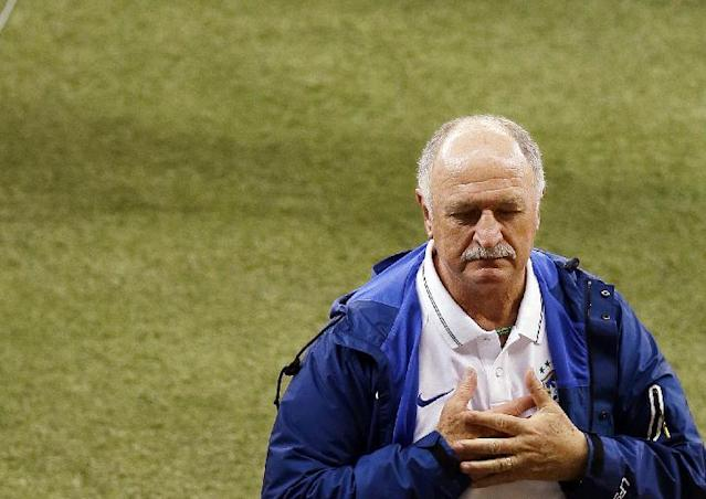 Brazil's coach Luiz Felipe Scolari leaves the pitch after the World Cup semifinal soccer match between Brazil and Germany at the Mineirao Stadium in Belo Horizonte, Brazil, Tuesday, July 8, 2014. Germany won 7-1.(AP Photo/Hassan Ammar)
