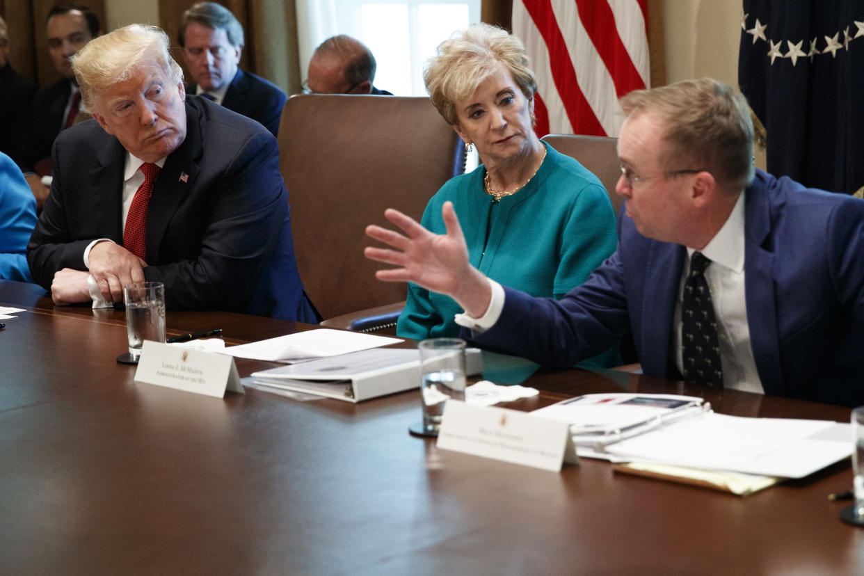 President Donald Trump, left, and Small Business Administration administrator Linda McMahon, center, listen as Director of the Office of Management and Budget Mick Mulvaney speaks. (Photo: AP Photo/Evan Vucci)