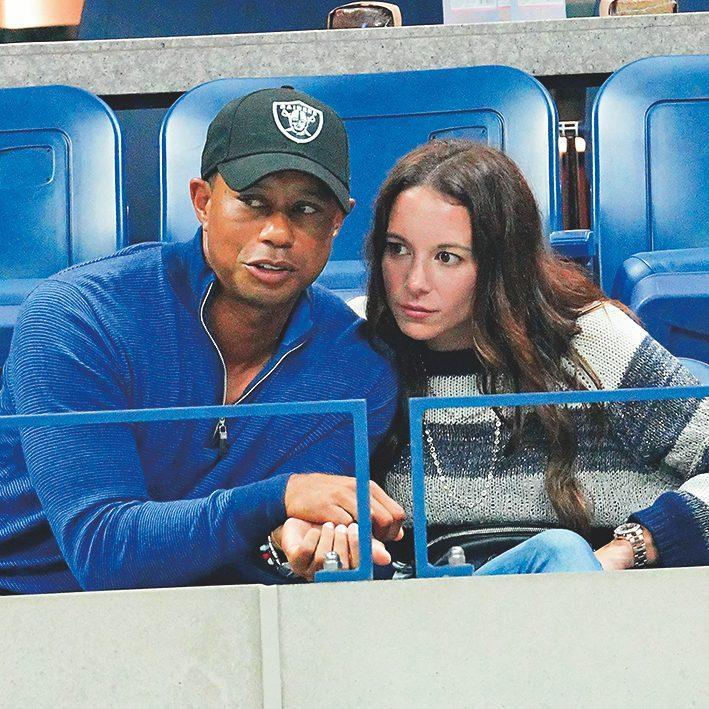 Woods with his girlfriend Erica Herman - Getty