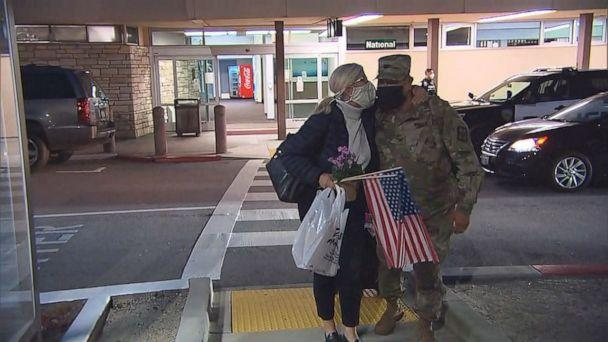 PHOTO: Col. Ramirez greets his wife after months apart. (ABC)
