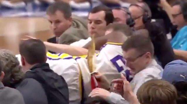 LSU's Emmitt Williams flew over the scorer's table trying to save a loose ball. (Screenshot: TruTV)