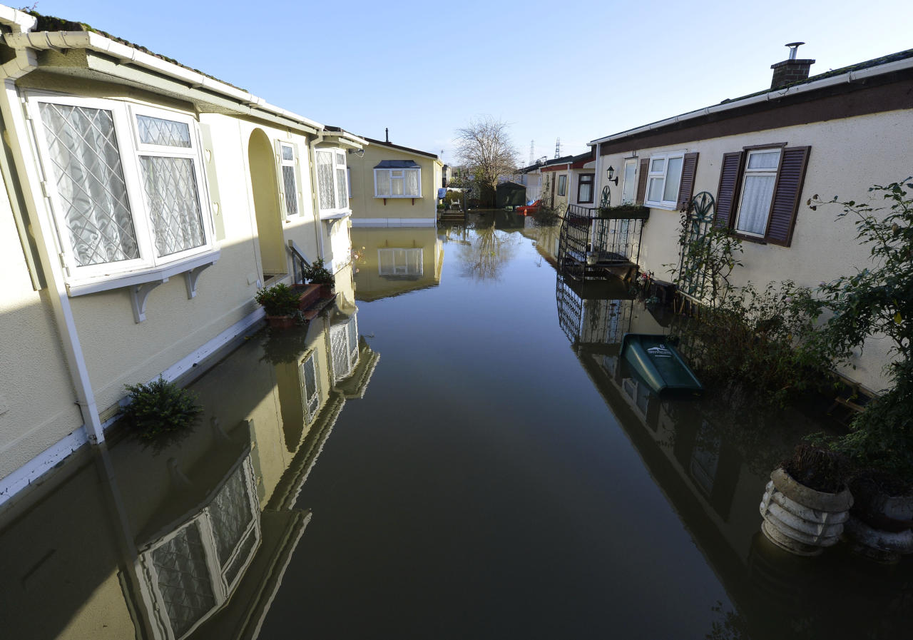 Riverside properties are seen partially submerged in floodwaters from the River Thames, at Chertsey in southern England