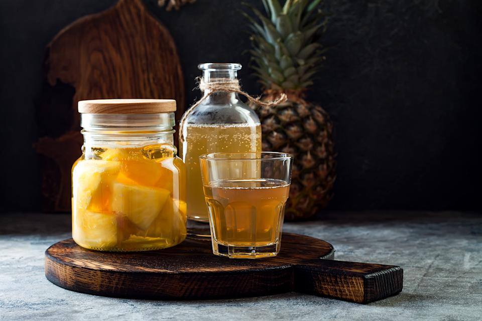 Fermented mexican pineapple Tepache. Homemade raw kombucha tea with pineapple. Healthy natural probiotic flavored drink. Copy space