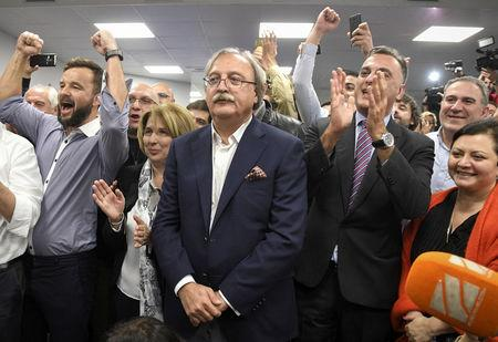 Grigol Vashadze, presidential candidate from the opposition United National Movement, surrounded by supporters reacts after the announcement of the first exit poll results in the presidential election in Tbilisi, Georgia October 28, 2018.  REUTERS/Irakli Gedenidze