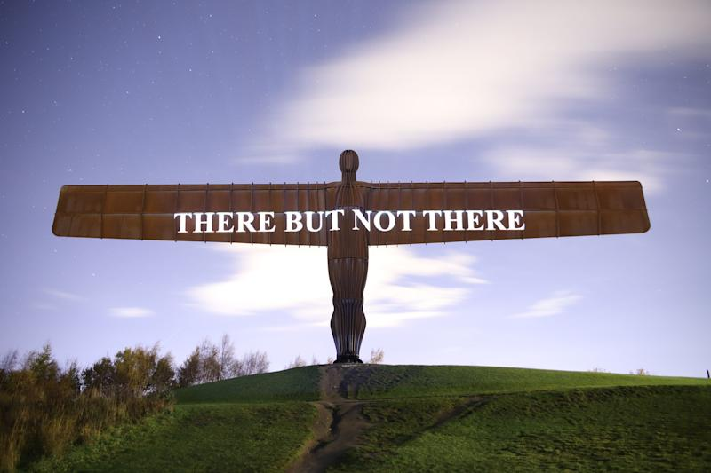 A message commemorating the British and Commonwealth troops who died in the First World War projected on to the Angel of the North