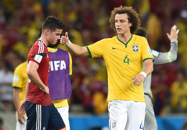 Colombia's James Rodriguez (left) is comforted by Brazil's David Luiz after the World Cup quarter-final at the Castelao Stadium in Fortaleza, on July 4, 2014 (AFP Photo/Vanderlei Almeida)