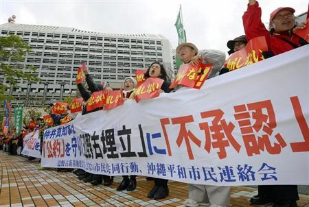 Protesters shout slogans during a rally against relocation of a U.S. military base in Naha, Okinawa prefecture