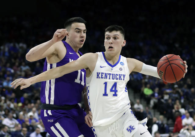 Kentucky's Tyler Herro (14) drives past Abilene Christian's Tobias Cameron (11) during the first half of a first-round game in the NCAA mens college basketball tournament in Jacksonville, Fla. Thursday, March 21, 2019. (AP Photo/John Raoux)