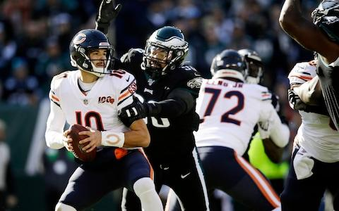 Chicago Bears' Mitchell Trubisky (10) is tackled by Philadelphia Eagles' Derek Barnett (96) during the first half of an NFL football game - Credit: AP