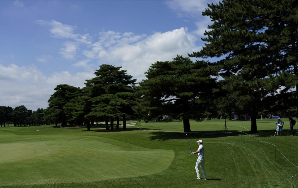 Japan's Rikuya Hoshino chips onto the 6th green during a practice round of the men's golf event at the 2020 Summer Olympics, Tuesday, July 27, 2021, at the Kasumigaseki Country Club in Kawagoe, Japan, (AP Photo/Matt York)