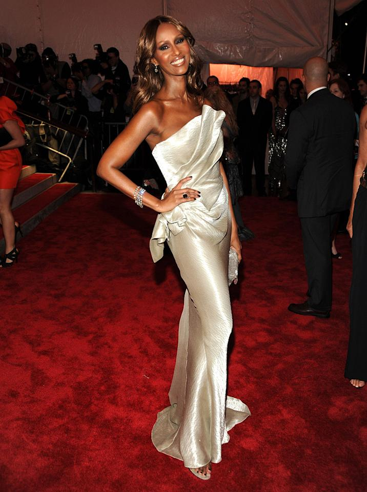 "David Bowie's main squeeze Iman dressed to impress in a strapless champagne creation, courtesy of Donna Karan. Kevin Mazur/<a href=""http://www.wireimage.com"" target=""new"">WireImage.com</a> - May 4, 2009"
