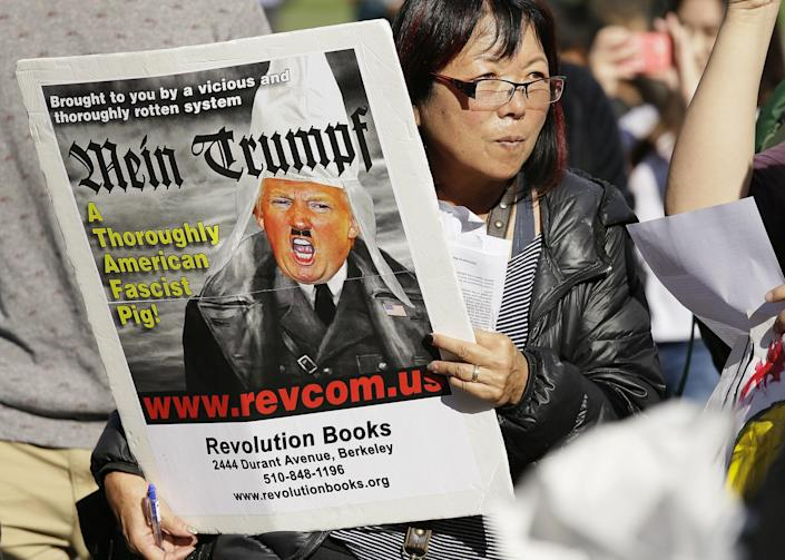 <p>A woman holds a photo of Donald Trump in opposition of Trump's presidential election victory in front of City Hall in San Francisco, Thursday, Nov. 10, 2016. (AP Photo/Eric Risberg) </p>