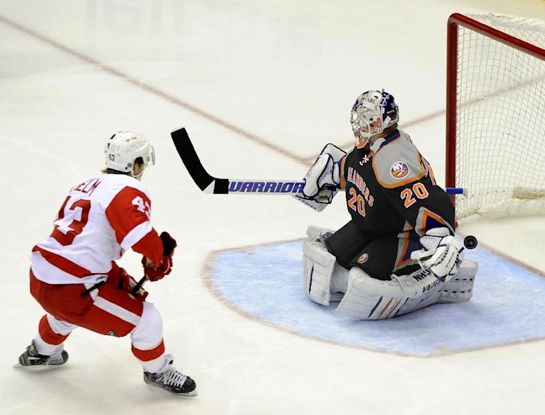 Detroit Red Wings center Darren Helm (43) shoots the puck past New York Islanders goalie Evgeni Nabokov (20) to score in the first period of an NHL hockey game on Saturday, Nov. 16, 2013, in Uniondale, N.Y. Nabokov left the ice with an injury after the play. (AP Photo/Kathy Kmonicek)