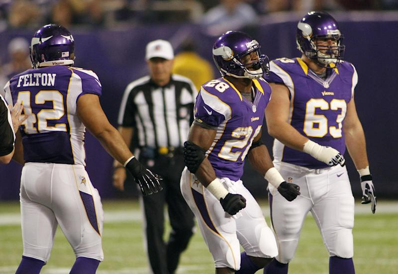 Minnesota Vikings running back Adrian Peterson, center, reacts in front of teammates Jerome Felton, left, and Brandon Fusco, right, after losing a fumble during the first half of an NFL football game against the Tampa Bay Buccaneers Thursday, Oct. 25, 2012, in Minneapolis. (AP Photo/Andy King)