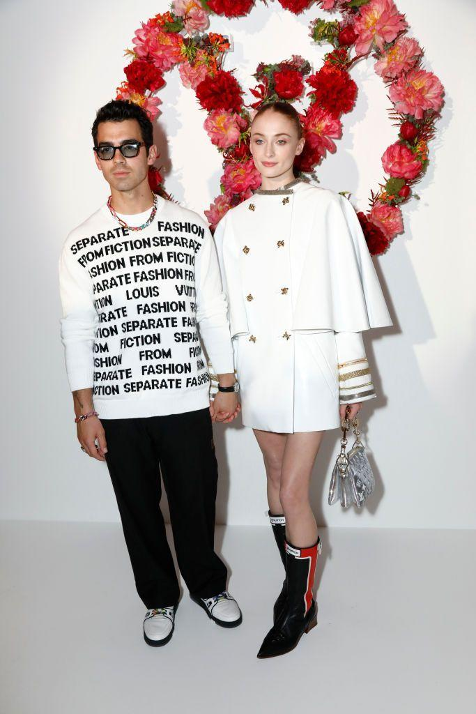 <p>The couple and parents posed in black, white, red and gold at the Louis Vuitton dinner. </p>