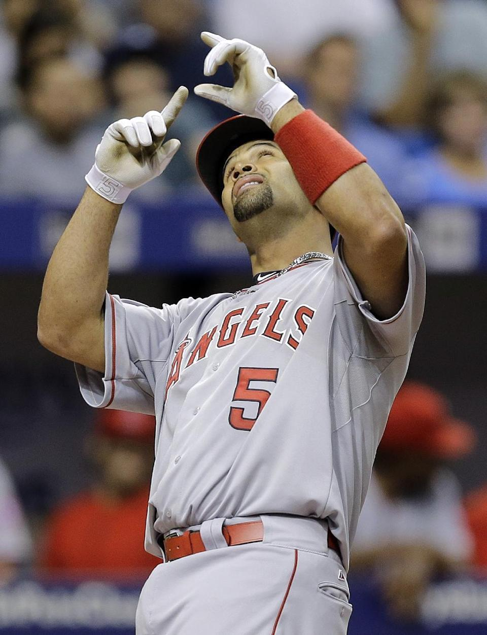Los Angeles Angels' Albert Pujols reacts after his home run off Tampa Bay Rays starting pitcher Nathan Karns during the fifth inning of a baseball game Tuesday, June 9, 2015, in St. Petersburg, Fla. (AP Photo/Chris O'Meara)