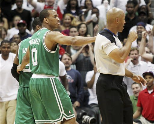 Boston Celtics' Avery Bradley, center, puts his arm around Rajon Rondo, rear left, and walks him off the court as he is ejected from the game by referee Marc Davis late in the fourth quarter of Game 1 of a first-round NBA basketball playoff series against the Atlanta Hawks, Sunday, April 29, 2012, in Atlanta. The Hawks won 83-74. (AP Photo/Atlanta Journal-Constitution, Curtis Compton) MARIETTA DAILY OUT; GWINNETT DAILY POST OUT