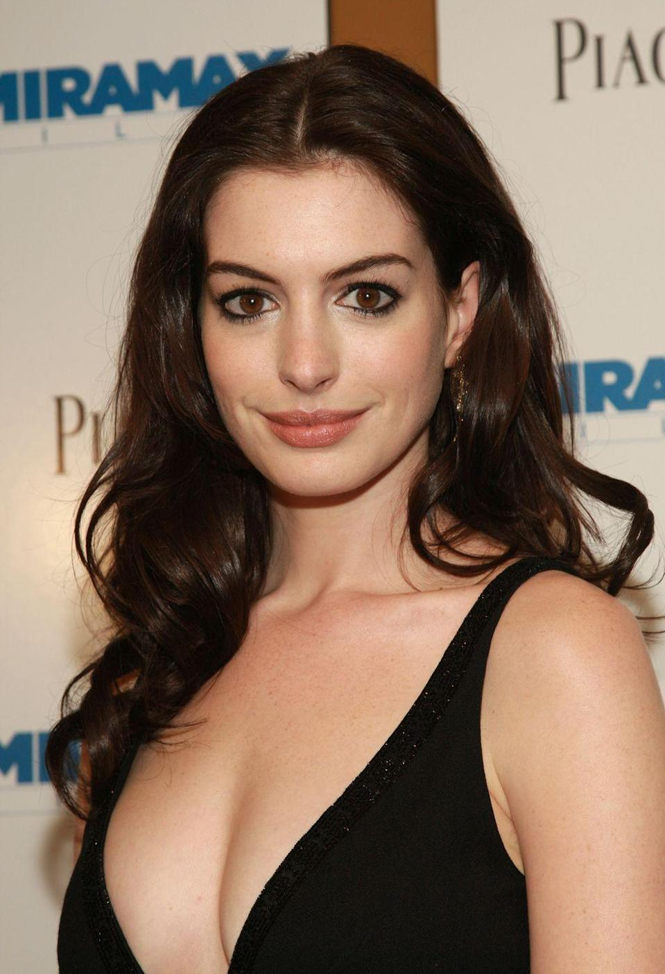 <p>Anne Hathaway rose to fame with leading roles in movies like <em>The Devil Wears Prada </em>and <em>The Princess Diaries</em>, and along the way became associated with her long brunette hair.</p>