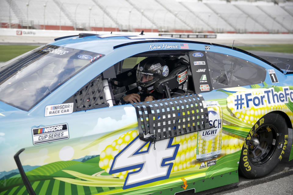 Kevin Harvick (4) gets ready before a NASCAR Cup Series auto race at Atlanta Motor Speedway, Sunday, June 7, 2020, in Hampton, Ga. (AP Photo/Brynn Anderson)