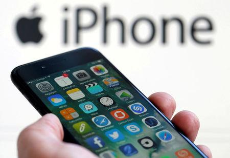 FILE PHOTO - An Apple iPhone 7 and the company logo are seen in this illustration picture taken in Bordeaux