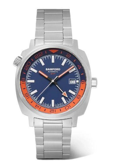 """<p>GMT </p><p><a class=""""link rapid-noclick-resp"""" href=""""https://www.watches-of-switzerland.co.uk/Bamford-GMT-GMT+SS+OR+BLU/p/18180057/"""" rel=""""nofollow noopener"""" target=""""_blank"""" data-ylk=""""slk:SHOP"""">SHOP</a></p><p>A handsome automatic steel watch inspired 'by travel', from independent London watchmaker George Bamford. His eye for detail has led to work with big name watch brands including Tag Heuer and Zenith, but Bamford's own line is always worth your time. Designed with a bold blue and orange dial, the GMT hand function lets you simultaneously view the time in two different zones.</p><p>£1,100; <a href=""""https://bamfordlondon.com/"""" rel=""""nofollow noopener"""" target=""""_blank"""" data-ylk=""""slk:bamfordlondon.com"""" class=""""link rapid-noclick-resp"""">bamfordlondon.com</a><br></p>"""